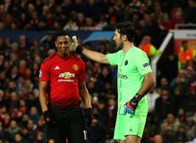 Manchester United v Paris Saint-Germain - UEFA Champions League Round of 16: First Leg. MANCHESTER, ENGLAND - FEBRUARY 12 2019: m11 and Gianluigi Buffon of PSG stock images