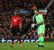 Manchester United v Paris Saint-Germain - UEFA Champions League Round of 16: First Leg. MANCHESTER, ENGLAND - FEBRUARY 12 2019: m11 and Gianluigi Buffon of PSG royalty free stock image
