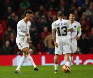 Manchester United v Paris Saint-Germain - UEFA Champions League Round of 16: First Leg. MANCHESTER, ENGLAND - FEBRUARY 12 2019:Thilo Kehrer of PSG and Dani Alves stock image