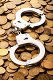 Manchettes et pièces de monnaie de main Photo libre de droits