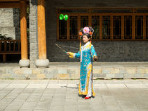 Manchirian girl juggling diabolo. In traditional clothes of chinese minority Stock Photos