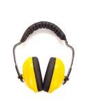Manchons protecteurs jaunes d'oreille Images stock