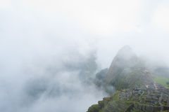 Manchu Picchu in the mist. This image shows the Manchu Picchu complex in Peru Royalty Free Stock Photos
