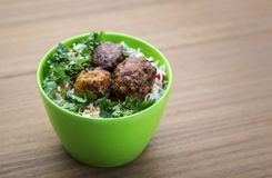 Manchurian with cooked rice in a bowl Royalty Free Stock Photo