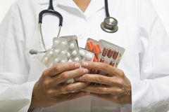Manciata di pillole Immagine Stock