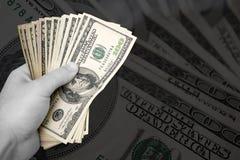Manciata di soldi Fotografie Stock Libere da Diritti