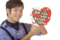Mand holding Oktoberfest gingerbread heart Royalty Free Stock Photography