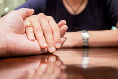 Mand holding woman hand with love royalty free stock photography