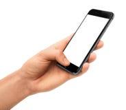 Mand que guarda o smartphone preto com tela vazia Imagens de Stock Royalty Free