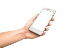 Mand que sostiene el smartphone blanco con la pantalla en blanco Fotos de archivo libres de regalías