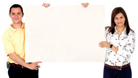 Mand and woman holding a banne Royalty Free Stock Photos