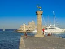 Mandaki harbor port and Fort of St. Nicholas in Rhodes Royalty Free Stock Photo