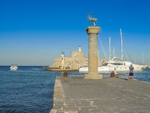 Mandaki harbor port and Fort of St. Nicholas in Rhodes stock image