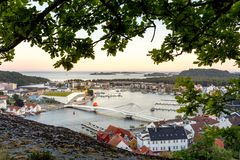 Mandal, Norway - june 2018: Mandal, a small town in the south of Norway. Seen from a height, with a cliff and an oak Royalty Free Stock Images