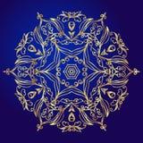 Mandala, amulet. Esoteric gold symbol on a blue background. Stock Photo