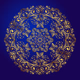 Mandala, amulet. Esoteric gold symbol on a blue background. Royalty Free Stock Photography