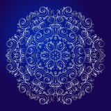 Mandala, amulet. Esoteric silver symbol on a blue background. Royalty Free Stock Photo