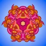 mandala Anaranjado-rosada en fondo azul Fotos de archivo libres de regalías