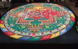 Mandala bouddhiste tibétain de sable Photos stock