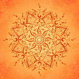 Mandala. Brown round ornament on orange background,  illustration Stock Photo