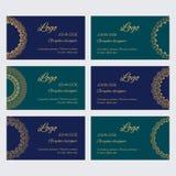 Set of luxury golden ornaments and frames on blue background. Mandala business card design template vector collection. Set of luxury golden ornaments and frames Royalty Free Illustration