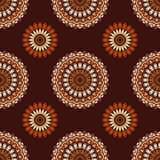 Hand drawn background with decorative elements in brown, orange and beige colors. Mandala colorful vector seamless pattern. Abstract geometric texture. Hand Vector Illustration