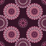 Hand drawn background with decorative elements in purple and pink colors. Mandala colorful vector seamless pattern. Abstract geometric texture. Hand drawn Stock Illustration