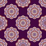 Abstract geometric texture. Hand drawn background with decorative elements in purple and orange colors. Mandala colorful vector seamless pattern. Abstract vector illustration