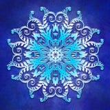 Mandala floral en fondo del azul del grunge Imagenes de archivo