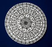 Mandala flower black and white on blue background royalty free stock photo