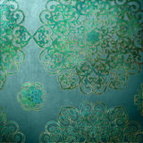 Mandala ocean background. Blue background with gold trimed mandala pieces Stock Images