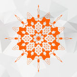 Mandala in orange color on gray triangles mesh Stock Photography