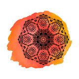 Mandala on the orange watercolor stain. Vector ornament, round decorative element for your design. Mandala on the orange watercolor stain. Vector ornament, round Stock Photo