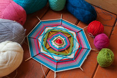 Mandala on the wooden skewers spokes thread wool different colors Royalty Free Stock Photography