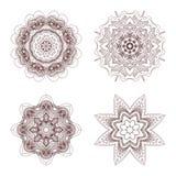 4 mandalas tirés par la main Image stock