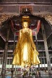 Buddha statue, Mandalay Hill, Burma. Mandalay, Burma - 2016, December 24 : A golden standing buddha halfway up the Mandalay Hill in Mandalay in central Myanmar stock photo