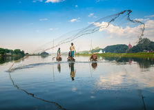 Mandalay - December 3: Fishermen catch fish Royalty Free Stock Photo