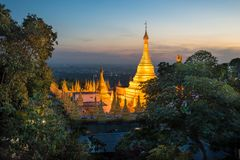 Mandalay Hill, Mandalay (Burma. View of a beautiful buddhist temple during the evening from a viewpoint at Mandalay stock photography