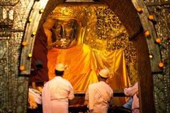 MANDALAY-MAY 3:Burmese woman pray while The ritual of face wash Royalty Free Stock Photos