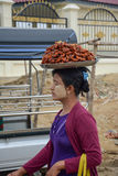 Mandalay, Myanmar - 02 August 2015: Woman selling traditional Burmese street food Stock Photo