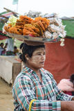 Mandalay, Myanmar - 02 August 2015: Woman selling traditional Burmese street food Stock Photography