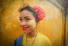 MANDALAY, MYANMAR, -DECEMBER 12, 2017 : Unidentified Myanmar girl with thanaka(yellow cosmetic paste) on her smile face. stock image