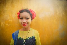 MANDALAY, MYANMAR, -DECEMBER 12, 2017 : Unidentified Myanmar girl with thanaka(yellow cosmetic paste) on her smile face. royalty free stock images