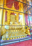 The lion throne in Mandalay Palace, Myanmar. MANDALAY, MYANMAR - FEBRUARY 23, 2018: The beautiful golden carved Lion Throne with sculptures of the King and the royalty free stock photo