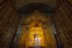 MANDALAY, MYANMAR, MARCH 23, 2015: Early morning ritual of face wash to Maha Myat Muni Buddha Image Stock Images