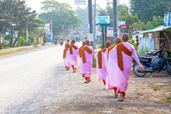 MANDALAY, MYANMAR- NOVEMBER 24 :The buddhist nuns are walking Royalty Free Stock Photo