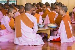 MANDALAY, MYANMAR - NOVEMBER 23, 2014: many unidentified Buddhi royalty free stock photo