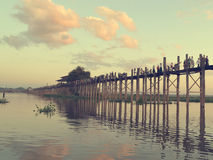 MANDALAY MYANMAR November 10, 2014. U-bein bridge. Local resident each pass, the longest wooden bridge. Silhouette Of Oban The Amarapura Royalty Free Stock Photography