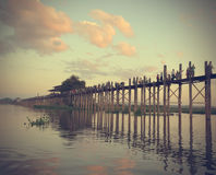 MANDALAY MYANMAR November 10, 2014. U-bein bridge. Local resident each pass, the longest wooden bridge. Silhouette Of Oban The Amarapura Royalty Free Stock Photos