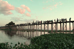 MANDALAY MYANMAR November 10, 2014. U-bein bridge. Local resident each pass, the longest wooden bridge. Silhouette Of Oban The Amarapura Royalty Free Stock Images